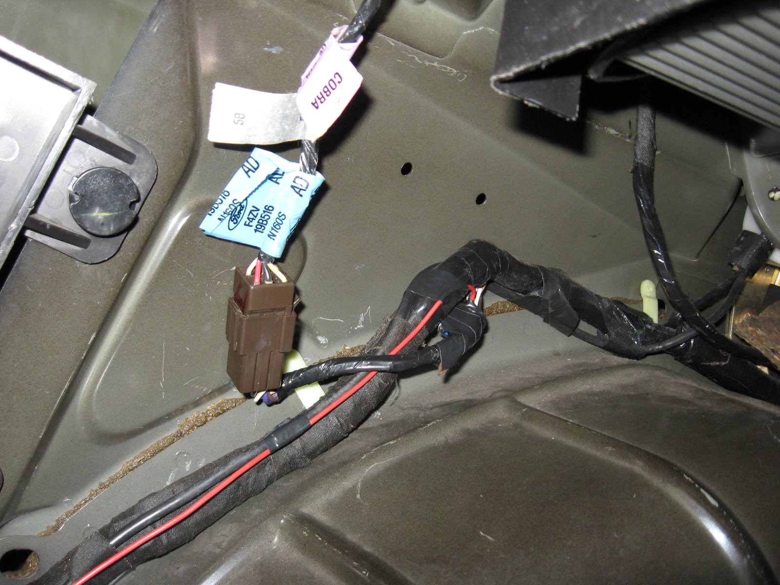 Mustang 1994 1995 Export Taillight Installation Cobra Tail Light Wiring Diagram Go Ahead And Wrap The Exposed Wires Up Along With Quick Splice Connector Run Red Wire Down Trunk Harness Using Electrical Tape Every Few